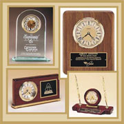 Wood, Glass and Acrylic Clocks.  Small desktop, mantel or wall mounted clocks for a functional award or gift!