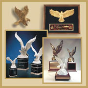 Majestic Eagles in stone, ceramic, metal and glass on bases and for wall plaques.  Also ceramic pelicans and Stone Obelisk are available.