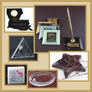 Glass, Crystal, Marble, Wood, Metal and Acrylic paperweights & pen sets with clocks and name blocks are available.
